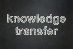 Education concept: text Knowledge Transfer on Black chalkboard background, 3d render
